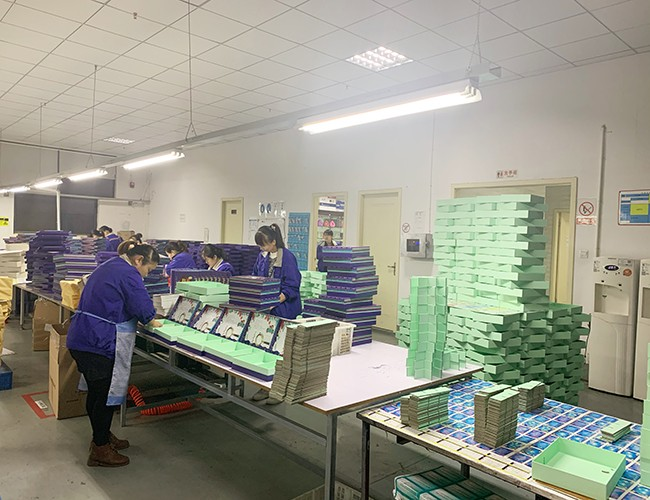 Workers Packing Goods